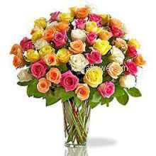 Beautiful 60 Mixed Vivid Color Roses in a Vase a wise choice to gift
