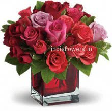 30 Valentine Red and Pink Roses in a Clear Glass Vase for your Love Surprise specially. Please note we may substitute vase or container as per availability.