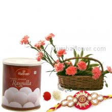Rakhi Package with  arrangement of 12 Pink Carnations, 1kg Rasgulla with one Rakhi & Roli Chawal. Best Gift for Raksha Bandhan