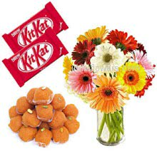 Glass Vase with 10 Mixed Gerberas and 1 kg. Motichur Ladoo with 2pc KitKat Chocolate