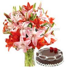 Glass Vase with 6 Pink and Orange Lilies and half kg. Chocolate Truffle cake