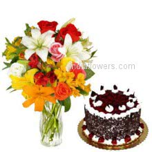 Glass Vase with 10 Mixed Colored Roses, 4 Mixed Colored Lilies nicely decorated with 1 kg. Black fores cake