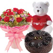 Bunch of 20 red roses nicely decorated with half kg. chocolate truffle cake and 12 inch teddy
