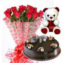 Bunch of 15 red roses nicely decorated with half kg. chocolate cake and 6 inch teddy