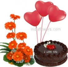 Arrangement of 15 Orange gerberas nicely decorated with half kg.chocolate truffle cake with balloons