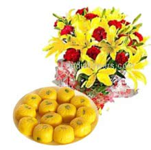 Bunch of 15 red carnation and 5 stems Yellow Lilies nicely decorated with 1 kg..kesar penda