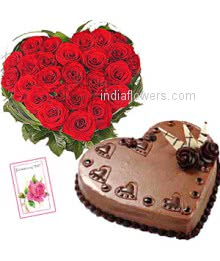 Heart shape arrangement of 50 red roses nicely decorated with 1 kg.chocolate cake heart shape and simple greeting card