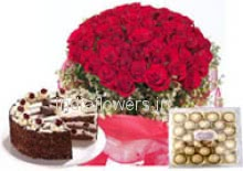 Bunch of 30 red roses nicely decorated with half kg. egg lase black forest cake and  24pc Ferrero Rocher Chocolate