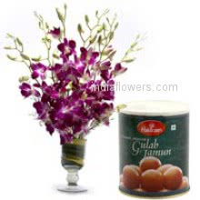 Glass vase with 10 orchids nicely decorated with 1 kg. gulab jamun