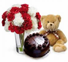 Glass vase with 30 red and white carnation nicely decorated with Half kg. chocolate truffle and 12 inch teddy