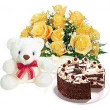 Bunch of 10 yellow roses nicely decorated with half kg. black forest cake and 6 inch teddy