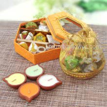 Potli Basket of Mixed Wrap Chocolates with Small Mithai Box and 4pc ready to use wax diyas. Contains 200gms Mixed Mithai,  8pc Chocolates and 3pc Decorative Diyas