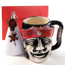 Combo of Pirates Mug with 1 Skull Key Chain and a personalised message <br><br> Size: 8cm x 8cm x 10cm approximately.