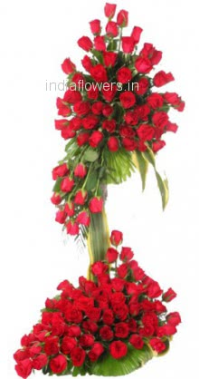 Tall Arrangement of 100 Red Roses nicely decorated with fillers and greens