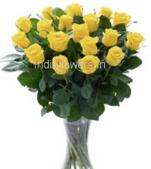 Glass Vase with 25 yellow Roses nicely decorated with fillers and greens.