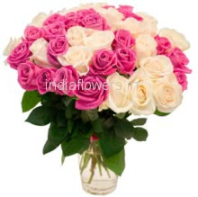 Glass Vase with 25 White and 25 Pink Roses nicely decorated with fillers and greens