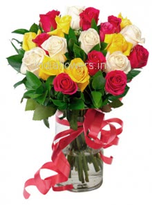 Glass Vase with 20 Mixed Colored Roses nicely decorated with greens.
