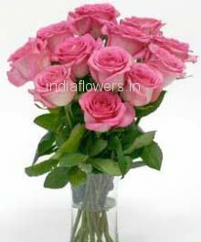 Glass Vase with 12 Pink Roses nicely decorated with greens.