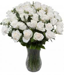 Glass vase with 40 White Roses nicely decorated with fillers