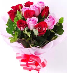 Hand Bouquet of 25 Red and Pink Roses nicely decorated with Paper Packing and ribbons