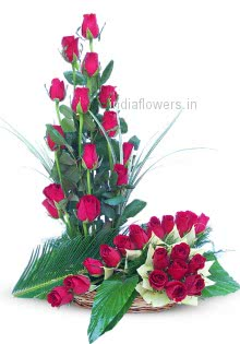 Arrangement of Sweet Red Roses nicely decorated with Fillers and Greens
