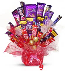 Bouquet of Mixed Chocolates, this chocolate gift contains 3pc Ferrero Rocher, 6pc Kitkats 18g., 6pc Dairy Milk 25g., 2pc Fuse 50g., 2pc Snickers 28g., 4pc Dairymilk Flavoured 36g., 1pc 5star 43g., 1pc Silk Bubbly 50g., 1pc Big Silk Chocolate Bar 137g. arranged beautifully with beautiful packing and ribbons. Please note we may substitute chocolate / flavours in case of unavailability.