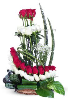 Stylish Arrangement of Red and White Roses nicely decorated , please note designs may vary as per delivery locations.