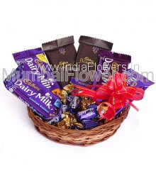 Basket of Dairymilk and Bournville Chocolates with eclairs, contains 2pc Bournville 31g. and 4pc Dairy milk flavoured 36g. and 5pc eclairs chocolates.