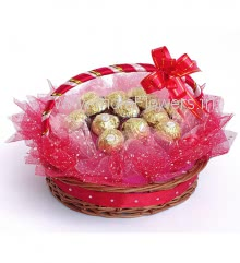 Beautiful Basket of 10pc Ferrero Rocher Chocolates nicely packed with Red and Pink Net Packing and ribbons