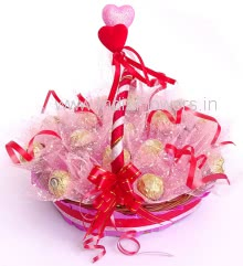 Beautiful Basket of 16pc Ferrero Rocher Chocolates nicely decorated with Pink Net Packing and Ribbons.