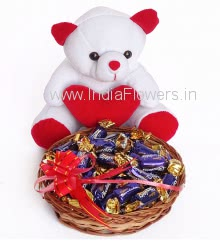 Small Basket of eclairs with stuff toy, Contains 1 small basket of 25pc Cabdury Eclairs and 6 Inch Teddy.