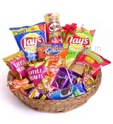 Basket of Namkins and Choclates, contains 1pc Pringle chips, 2pc Lays wafers, 1pc Kurkure, 1pc Bujia Sev, 2pc Litte Heart Pouch, 1pc Cadbury Silk 55g., 2pc 5 Star 43g., 1pc Oreo 120g. and 5pc Dairymilk Chocolates 13g. each