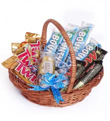 Basket of Chocolates. Contains 4pc Bounty Coconut Chocolates 57g., 3pc Twix 50g., 3pc Mars (contain eggs) 51g. and 3pc Ferrero Rocher Chocolates in Beautiful Basket and Ribbons