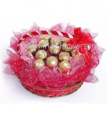 Basket of 13pc Ferrero Rocher Chocolates nicely decorated with Red and Pink net and Ribbons.