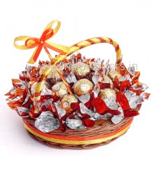 Basket of 13pc Premium Ferrero Rocher Chocolates nicely decorated with Orange metallic cellophone and ribbons