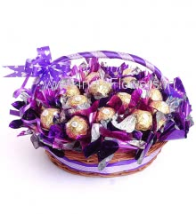 Basket of 16pc Premium Ferrero Rocher Chocolates nicely decorated with Purple metallic cellophone and ribbons