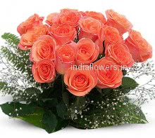Bouquet of 24 Orange Fresh Roses nicely decorated with Fillers and Ribbons