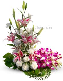 Deluxe Arrangement of 3 Pink Lilies 10 Purple Orchid and 20 Mixed Roses and Carnations nicely decorated.