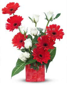 Red Gerberas in a vase with Roses