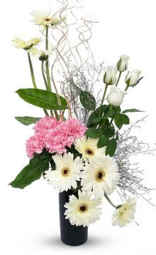 10 Pink Carnation, 10 White Roses and 10 Gerberas in a glass vase. Please note we may substitute type of flowers / color of flowers in case of unavailability.
