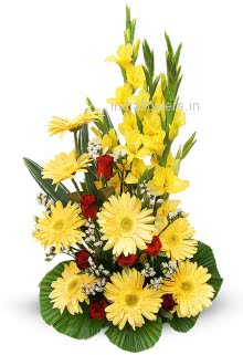 Arrangement of Yellow Gerbera Gladioli and Roses nicely decorated