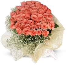 Flower Bunch of 40 Pink Roses nicely decorated with fillers and Ribbons