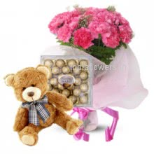 A combination of gift can be gift to the mother of new born baby or to your love Bunch of 20 carnation. 24 pc Ferroro Rocher Chocolate. 12 inches Teddy
