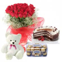 A special combo of Bunch of 20 Red Roses, Half Kg. Black Forest cake, 6 Inch Teddy and 16pc Ferrero Rocher for your sweet heart
